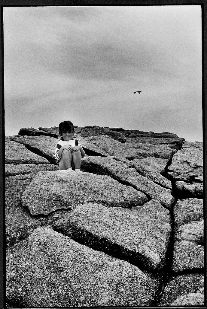 girl, rocks and kite